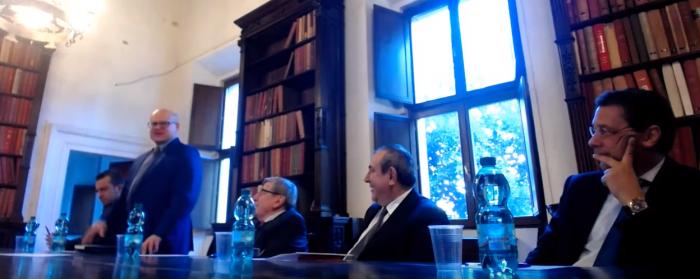 Klishin standing. Former Italian politician Vincenzo Scotti with Joseph Mifsud and Stephan Roh.